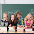 Laughing group of school kids in class — Stockfoto #51325015
