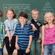 Young school children in class — Stock Photo #51325021