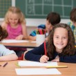 Happy young girl in class at school — Stock Photo #51325137
