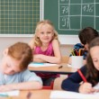 Cute pretty blond girl in class — Stock Photo #51325177