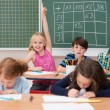 Intelligent enthusiastic little girl in class — Stock Photo #51325237