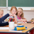 Serious little girl in class at school — Stock Photo #51325617