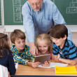 Young children using tablet in class — Stock Photo #51325937