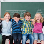 Happy laughing children in school — Stock Photo #51326067
