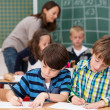 Children in class writing notes at school — Stock Photo #51326209