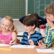 Young children laughing at a classmate — Stock Photo #51326257