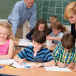 Two teachers with their young students — Stock Photo #51326291