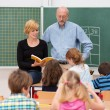 Teacher with his teaching assistant — Stock Photo #51326399