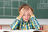 Boy concentrating on his schoolwork — Stock Photo