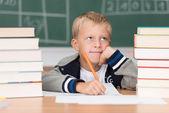 Boy working at desk in school — Stock Photo