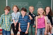Young school children in class — Stock Photo