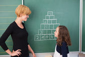 Teacher and young girl on maths class — Foto Stock