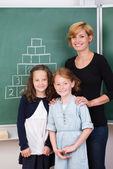 Two young girls with their teacher — Stock Photo