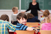 Cute little boy in class at school — Stok fotoğraf
