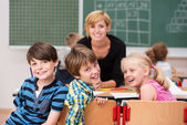 Three laughing happy school children — Stockfoto