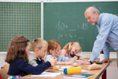 Elderly male teacher in primary school — Foto de Stock