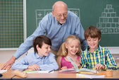 Children in school with their teacher — Stock Photo