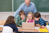 Young school kids in class — Stock Photo