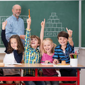 Group of intelligent young schoolchildrfen — Stock Photo