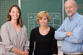 Group of three school teachers — Stock Photo