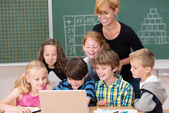 Children ion class with teacher — Stock Photo
