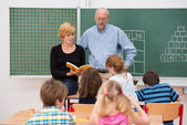 Teacher with his teaching assistant — Foto Stock