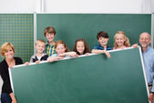 Young students and teachers — Stock Photo