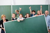 Cheering happy young school children — Stock Photo