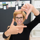 Businesswoman creating frame with fingers — Stock Photo