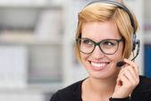 Attractive woman call centre operator — Stock Photo