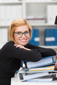 Hardworking young woman in office — Stock Photo