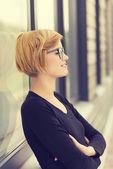 Businesswoman standing taking break — Stock Photo