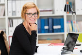 Young businesswoman doing paperwork — Stock Photo