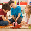 Children playing with a piggybank — Stock Photo #25994013