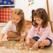 Girls playing with blocks — Stock Photo #26019715