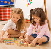 Girls playing with blocks — Stock Photo