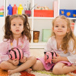 Little girls holding piggybanks — Stock Photo