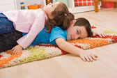 Two children resting — Stock Photo