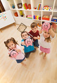 Children playing with piggybanks — Stock Photo