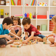 Children playing with blocks — Stock Photo