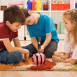 Children playing with a piggybank — Stock Photo