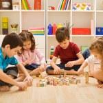 Children playing with blocks — Stock Photo #26444355