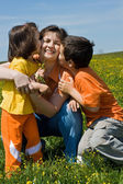Happy family on the grass — Foto Stock