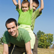 Stock Photo: Happy family playing on the meadow