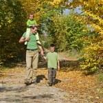 Happy family walking on the path — Stock Photo