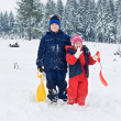 Children staying in snow — Stock Photo #27713643