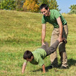 Stock Photo: Father and son playing outside