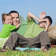 Family resting outside — Stock Photo #27839549