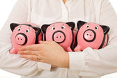 Businesswoman holding piggy-banks — Stock Photo