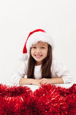 Little christmas girl with a big grin — Stock Photo